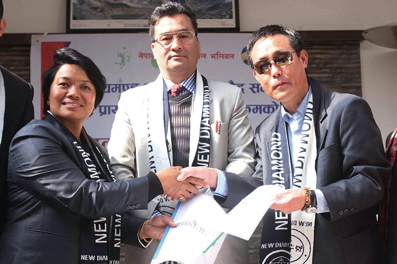 Sunkeshari Mali (left) President of New Diamond Academy exchanges MoU with Sonam Wangdi Bhutia (right) Country Director of Hongwanji Buddhist Society while Jitendra Chand General Secretary of Nepal Volleyball Association look on during MoU signing ceremony in Kathmandu on Wednesday.