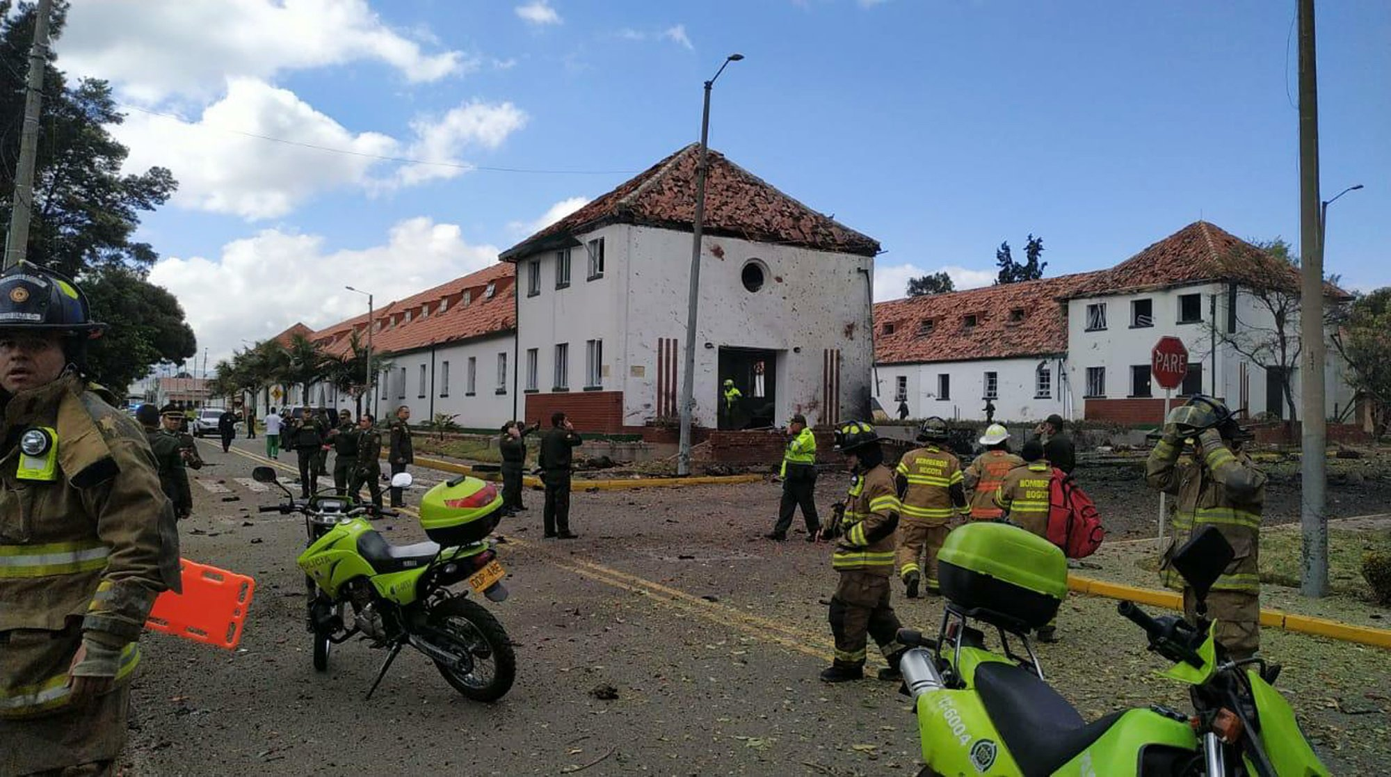 In this image provided by military personnel, emergency personnel respond to the scene of a deadly car bombing at a police academy on Thursday, Jan. 17, 2019, in Bogota, Colombia.