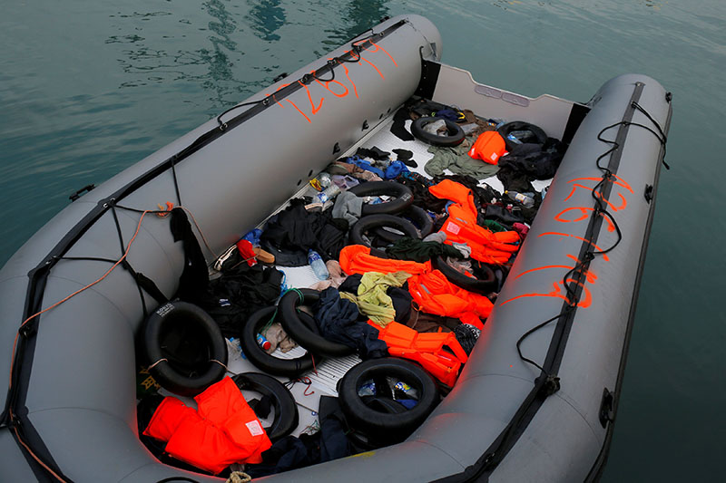 A dinghy with floats and life-vests of migrants, intercepted aboard of it off the coast in the Mediterranean Sea, is seen after they arrived on a rescue boat at dawn at the port of Malaga, southern Spain, January 15, 2019. Photo: Reuters