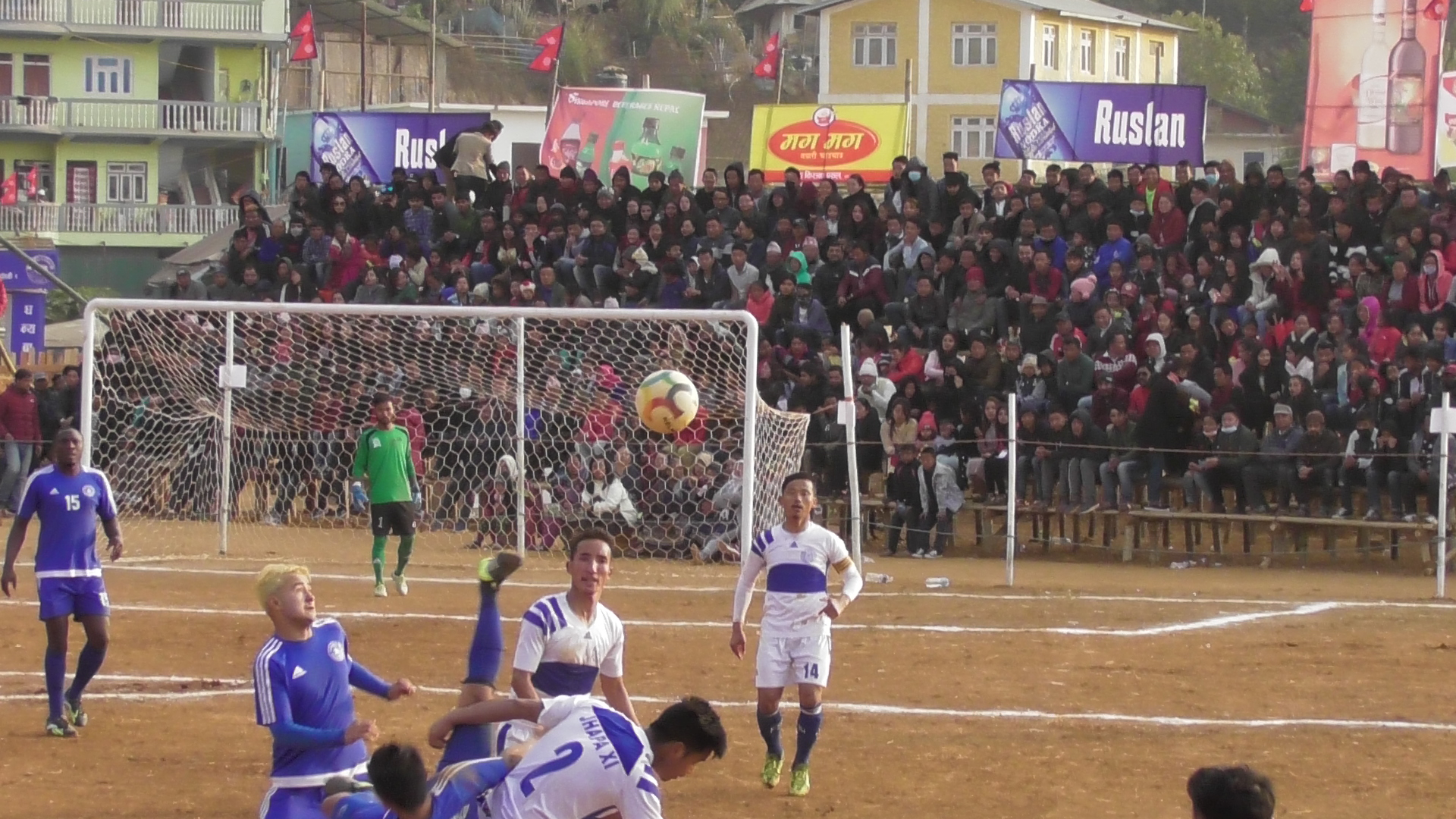 Players of Jhapa-XI and Saraswati Youth Club (left) in action during the 10th Ruslan Falgunanda Gold Cup match in Phidim on Friday, January 11, 2019. Photo: THT