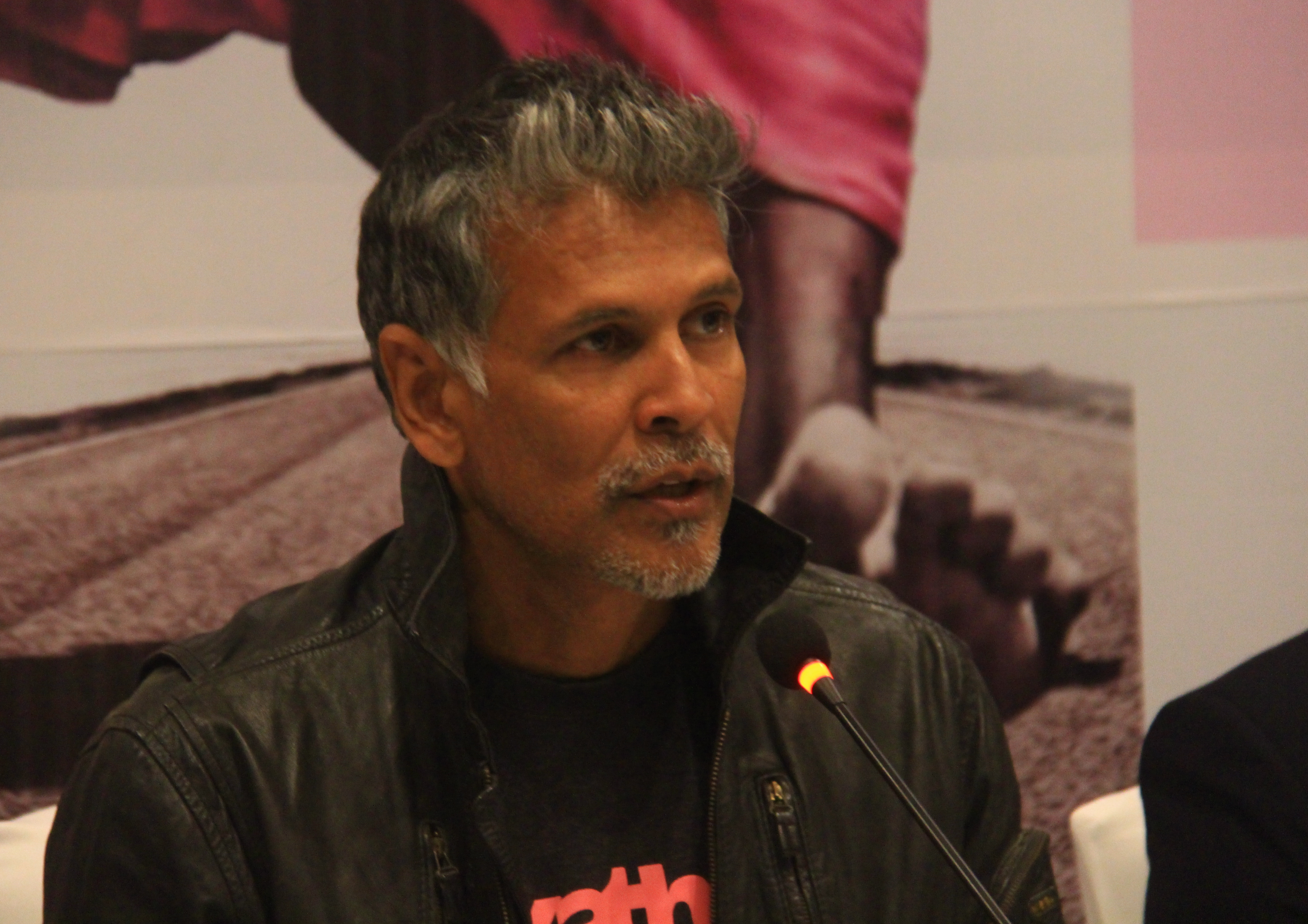 Founder of United Sisters Foundation and Indian actor Milind Soman (second from left) gestures as others look on during a press meet in Kathmandu on Friday.