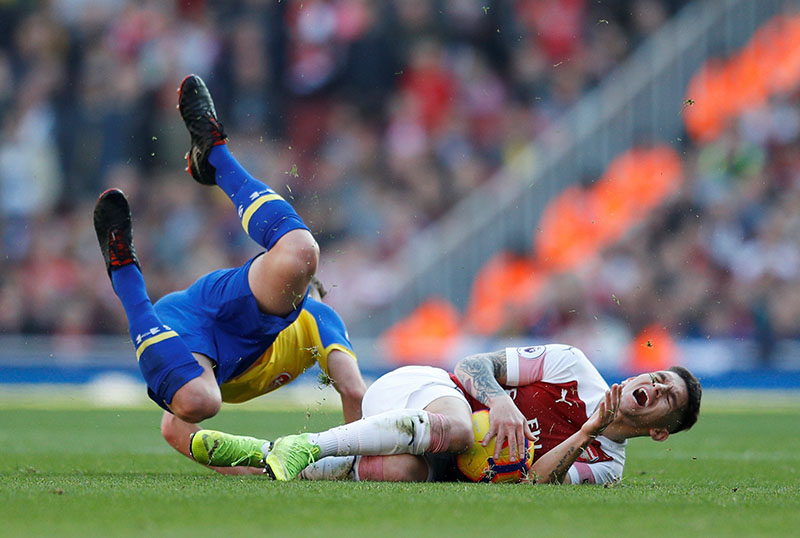 Arsenal's Lucas Torreira in action with Southampton's James Ward-Prowse during the Premier League match between Arsenal and Southampton, at Emirates Stadium, in London, Britain, at February 24, 2019. Photo: Reuters