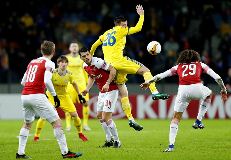 Arsenal's Granit Xhaka and Matteo Guendouzi in action with BATE Borisov's Nemanja Milic during the Europa League Round of 32 First Leg match bewteen BATE Borisov and Arsenal, at Borisov Arena, in Barysaw, Belarus, on February 14, 2019. Photo: Reuters