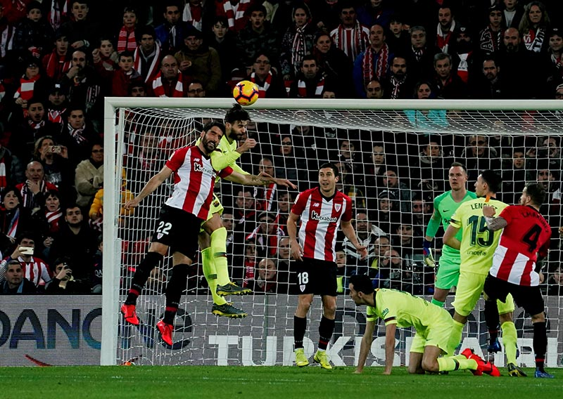 Barcelona's Gerard Pique in action with Athletic Bilbao's Raul Garcia during the La Liga Santander match between Athletic Bilbao and FC Barcelona, on San Mames, in Bilbao, Spain, on February 10, 2019. Photo: Reuters