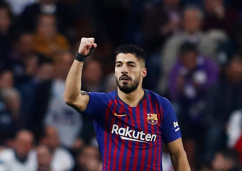 Barcelona's Luis Suarez celebrates scoring their first goal during the Copa del Rey Semi Final Second Leg match between Real Madrid and FC Barcelona, at Santiago Bernabeu, in Madrid, Spain, on February 27, 2019. Photo: Reuters