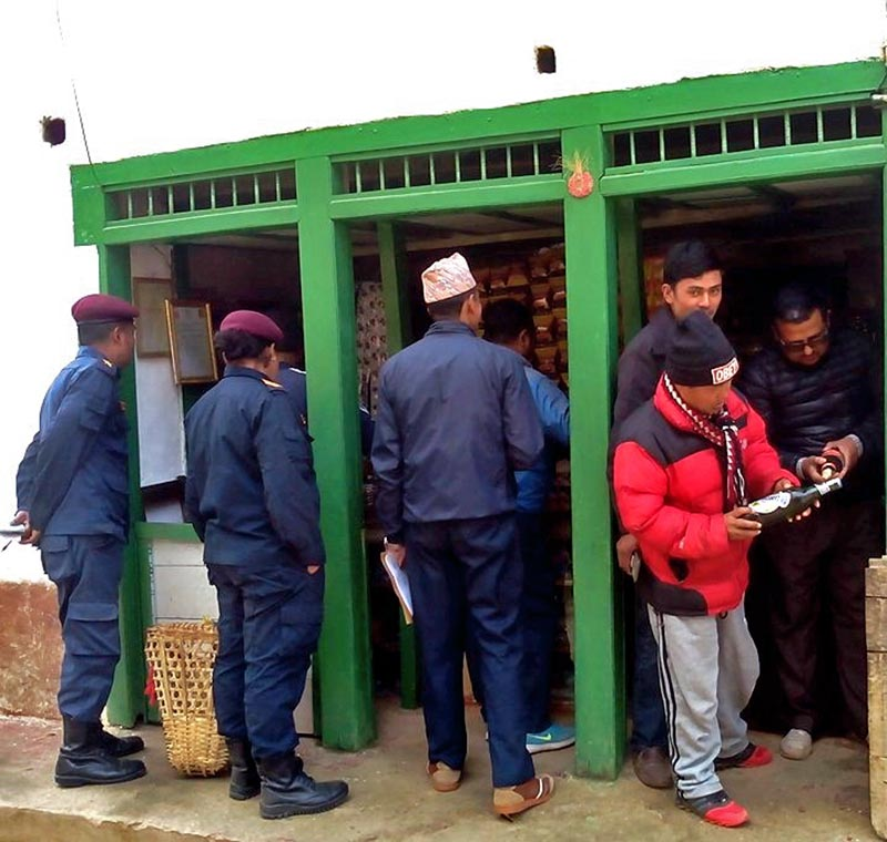 The market monitoring team from Bhojpur District Administration Office inspecting a store in Bhojpur district, on Thursday, February 21, 2019. Photo: Niroj Koirala/THT