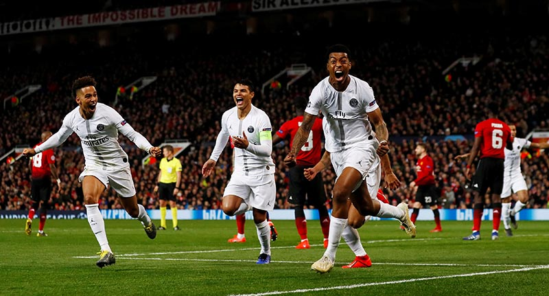 Paris St Germain's Presnel Kimpembe celebrates scoring their first goal with Thiago Silva and Thilo Kehrer during the Champions League Round of 16 First Leg match between Manchester United and Paris St Germain, at Old Trafford, in Manchester, Britain, on February 12, 2019. Photo: Action Images via Reuters