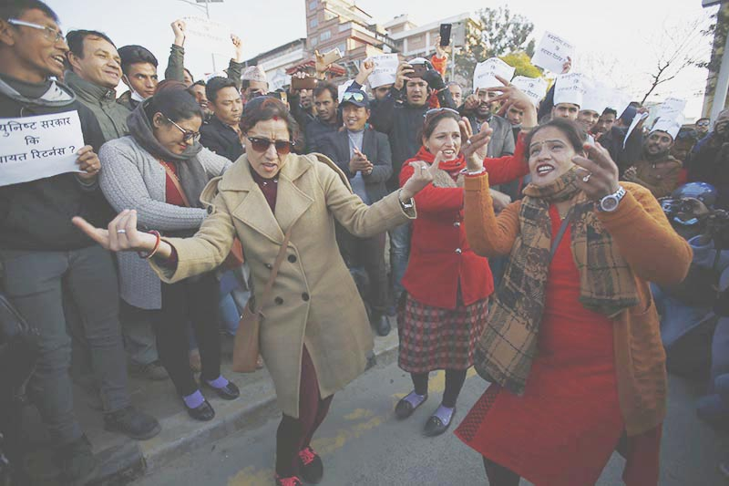 Activists dancing to the tune of controversial song 'Lootna Sake Loot' to protest threats against folk singer Pashupati Sharma, who was forced to remove the song from YouTube, at Maitighar,  Kathmandu, on Sunday. . Photo: Skanda Gautam/THT
