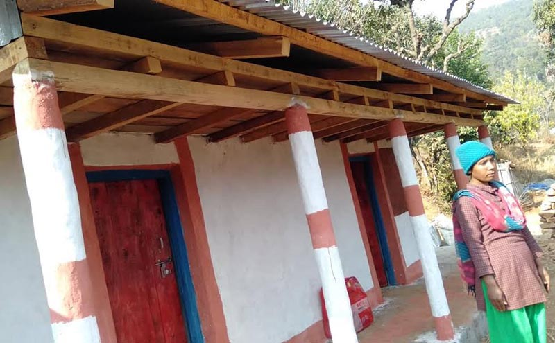 A woman standing in front of her newly-constructed house in Namdu, Dolakha, on Monday, February 18, 2019.  She has not received the housing grant provided by the government.