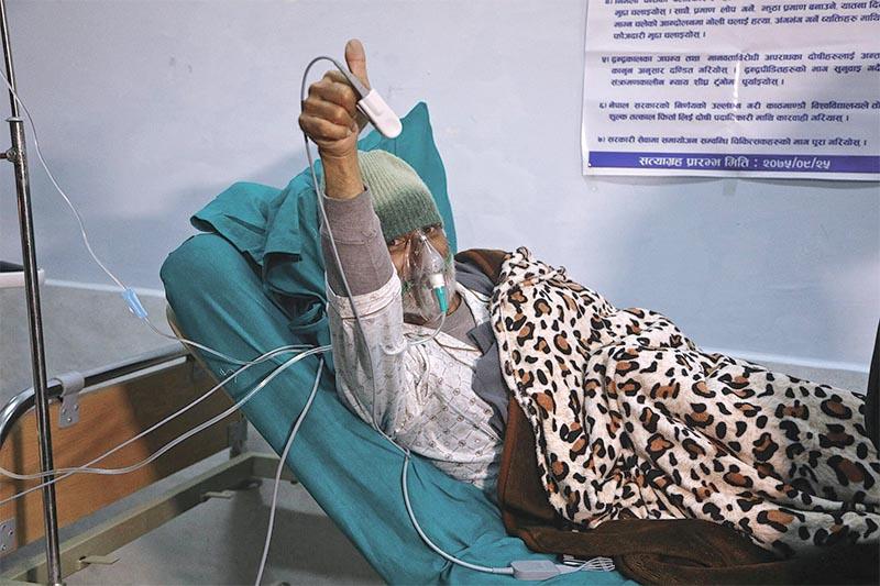 Senior orthopaedic surgeon Dr Govinda KC giving a thumbs-up sign after ending his fast-unto-death after n24 days at TU Teaching Hospital, in Kathmandu, on Friday, February 1, 2019. Photo: Skanda Gautam/THT