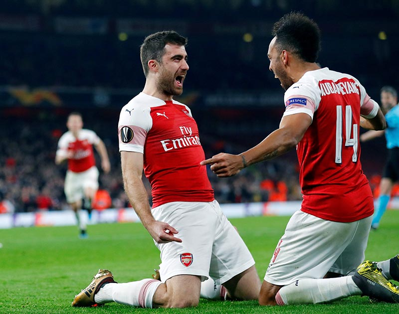 Arsenal's Sokratis Papastathopoulos celebrates scoring their third goal with Pierre-Emerick Aubameyang  during the Europa League Round of 32 Second Leg match between Arsenal and  BATE Borisov, at  Emirates Stadium, in London, Britain, on February 21, 2019. Photo: Reuters