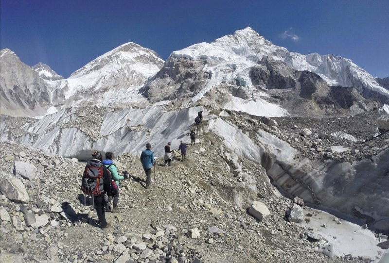 FILE - In this Monday, Feb. 22, 2016 file photo, trekkers pass through a glacier at the Mount Everest base camp, Nepal. Photo: AP
