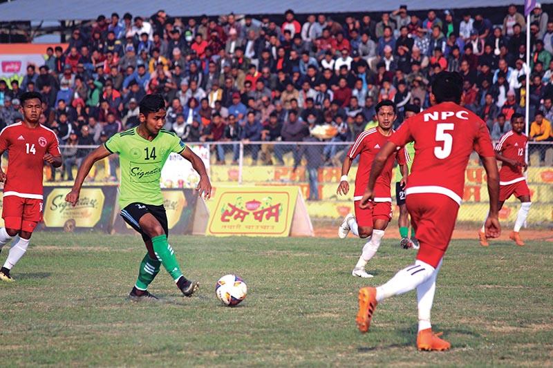 Anjan Bista of Manang Marshyangdi Club shoots the ball against Nepal Police Club during the Madan Bhandari Memorial Itahari Gold Cup in Sunsari on Thursday. Photo: THT
