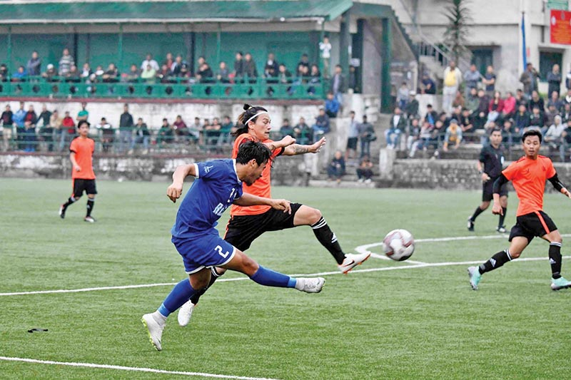Action in the match between Ruslan Three Star Club (left) and United Bothers during the Jigme Dorjee Wangchuk Memorial Gold Cup in Phuntsoling on Wednesday. Photo Courtesy: NSJF