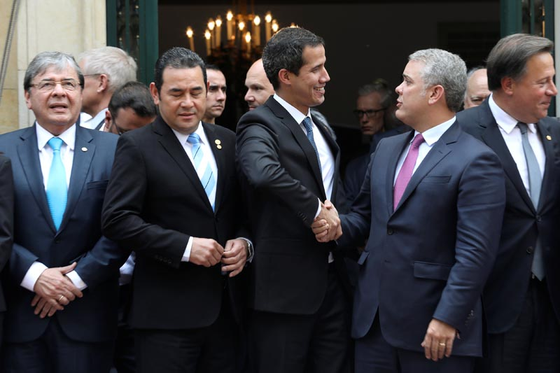 Venezuelan opposition leader Juan Guaido, who many nations have recognized as the country's rightful interim ruler, shakes hands with Colombia's President Ivan Duque, after a meeting of the Lima Group in Bogota, Colombia, February 25, 2019.Photo: Reuters