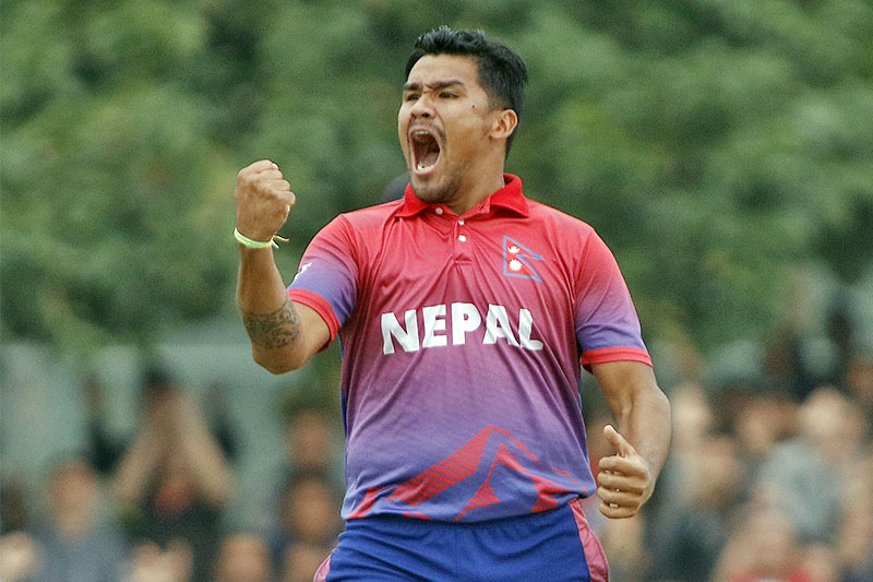 FILE: Nepal seam bowler Karan KC celebrates after thumping UAE in T20 Int'l in Dubai. Photo: ICC