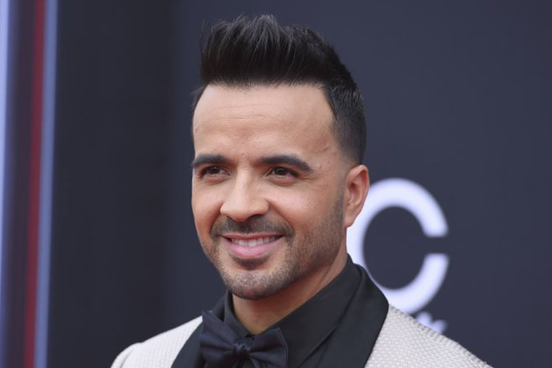 FILE - In this May 20, 2018 file photo, Luis Fonsi arrives at the Billboard Music Awards in Las Vegas. Fonsi will release a new album, u201cVida,u201d on Friday, Feb. 1, 2019. Photo: AP