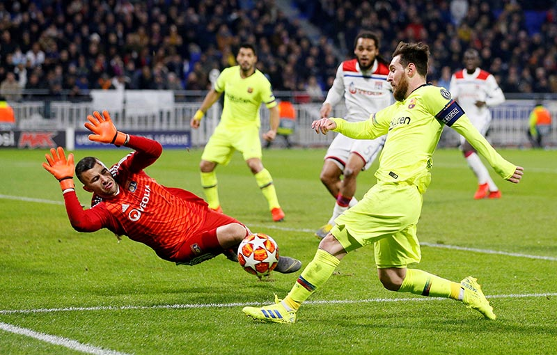 Lyon's Anthony Lopes makes a save from Barcelona's Lionel Messi during the Champions League Round of 16 First Leg  Olympique Lyonnais v FC Barcelona - Groupama Stadium, Lyon, France - February 19, 2019
