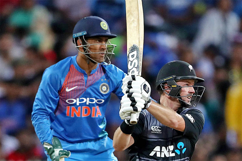 New Zealand opener Colin Munro plays a shot as Indian wicket-keeper MS Dhoni looks on during their T20 Int'l in Hamilton, on Sunday, February 10, 2019. Photo: ICC