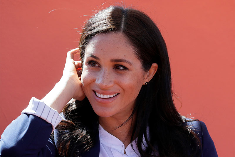 Britain's Meghan, Duchess of Sussex reacts during the investiture of Michael McHugo, founder of the Moroccan NGO 'Education for All', with the Most Excellent Order of the British Empire, in Asni, Morocco, February 24, 2019. Photo: Reuters