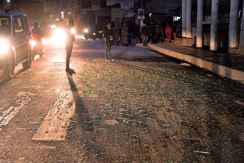 This image shows shards of glass shattered from roadside showrooms littered on the street outside Ncell office in Nakkhu, Lalitpur, on Friday, February 22, 2019. The blast outside Ncell office left three people injured. Photo: Naresh Shrestha/THT