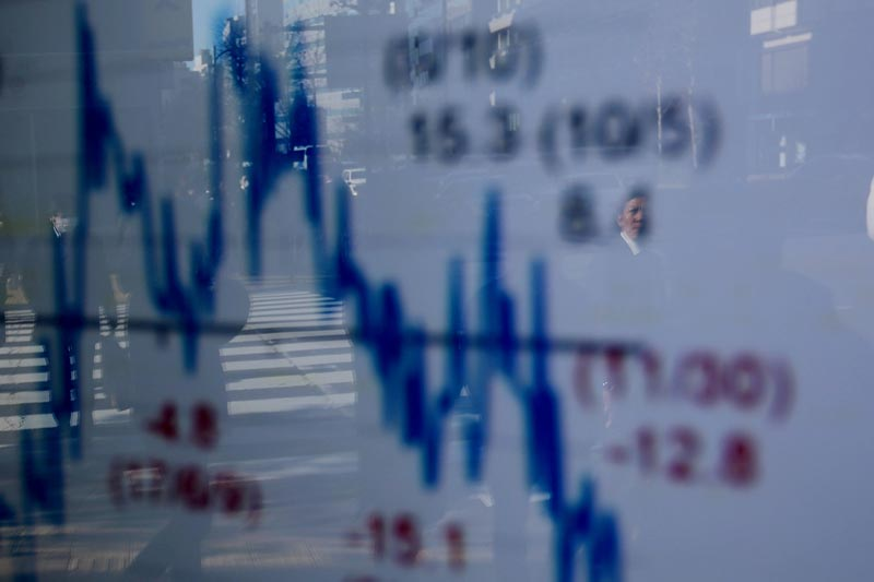 FILE: A man is reflected on an electronic board showing a graph analyzing recent change of Nikkei stock index outside a brokerage in Tokyo, Japan, January 7, 2019.Photo: Reuters/file