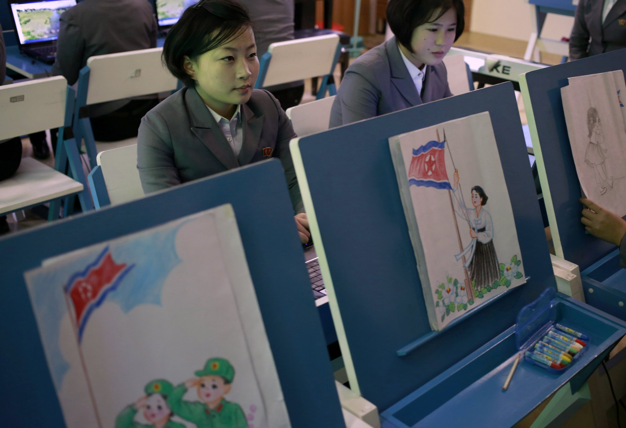 In this Tuesday, Jan. 29, 2019, photo, students make story boards depicting North Korean flags being raised during a multi media production class at Pyongyang Teachers' University, a teacher training college, in Pyongyang, North Korea. Photo: AP