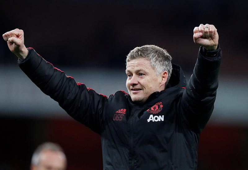 FILE PHOTO: Soccer Football -  FA Cup Fourth Round - Arsenal v Manchester United - Emirates Stadium, London, Britain - January 25, 2019   Manchester United interim manager Ole Gunnar Solskjaer celebrates after the match. Action Images via Reuters/Matthew Childs/File Photo