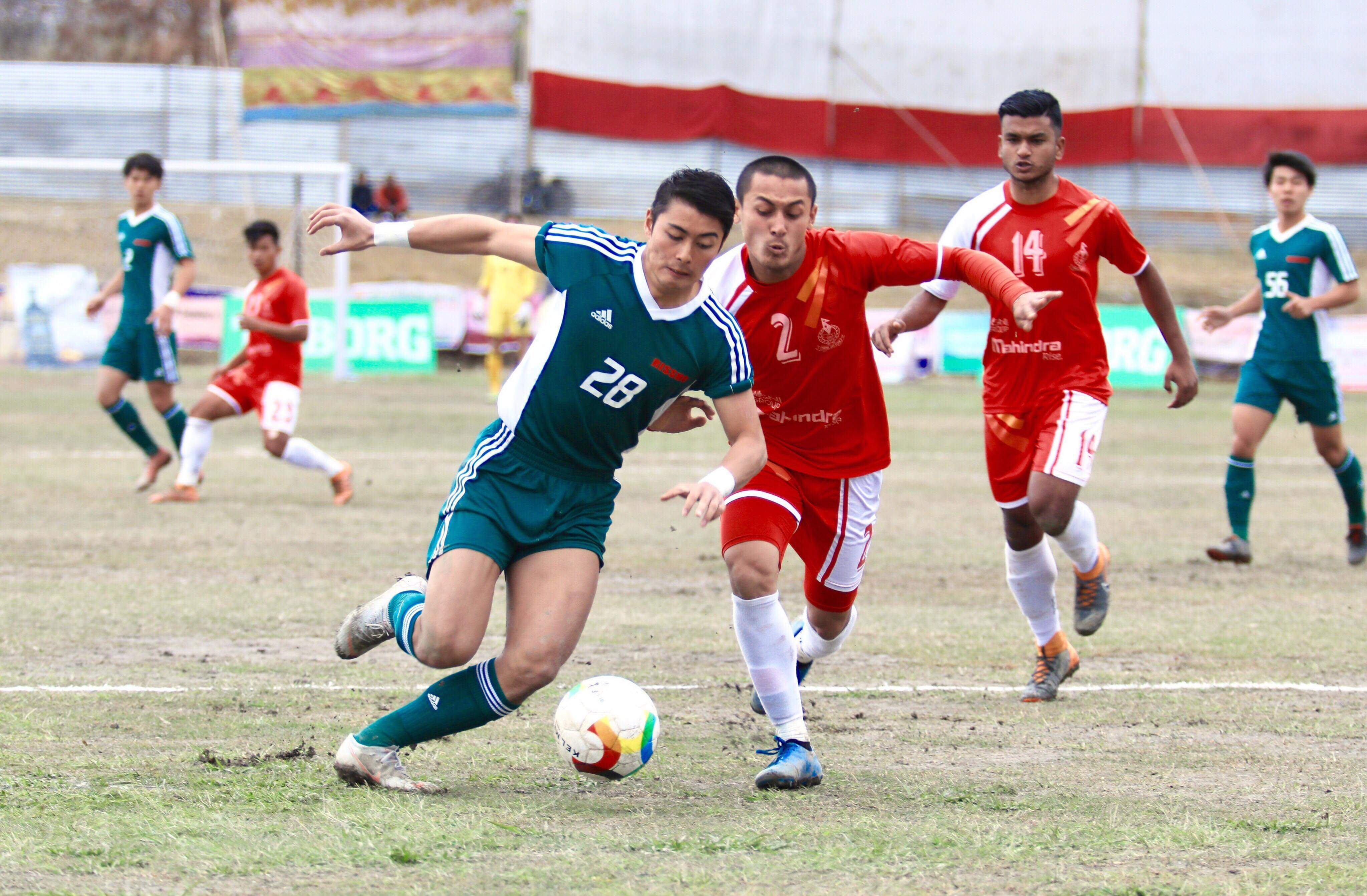 Players of Nepal APF Club and Rissho University (left) of Japan vie for the ball during their semi-final match of the sixth Manakamana Cable Car Pokhara Cup at the Pokhara Stadium on Friday. APF won the match 4-1 on penalties. Photo: THT