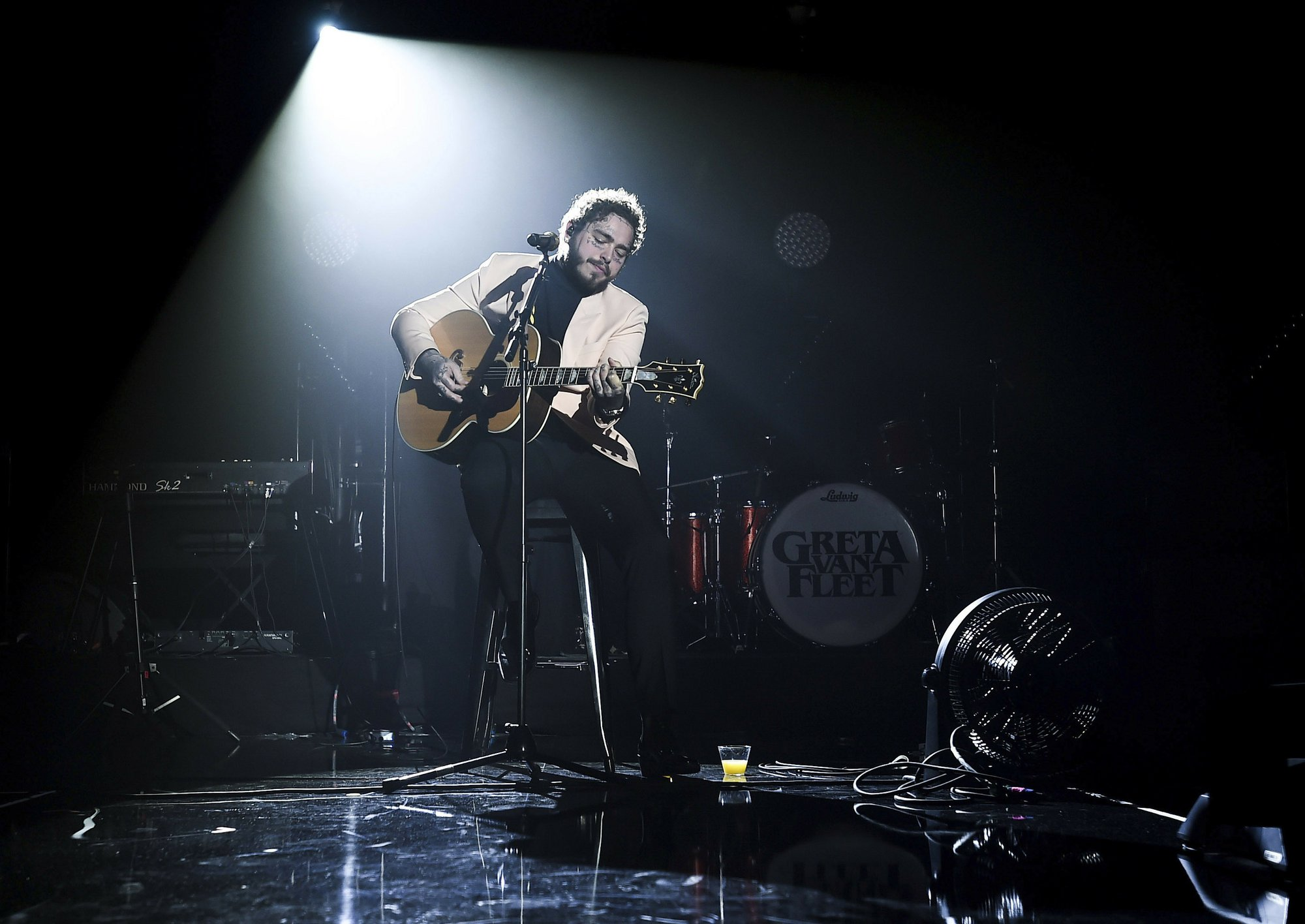 In this photo provided by Universal Music Group, Post Malone performs at Sir Lucian Grainge's 2019 Artist Showcase Presented by Citi on Saturday, Feb. 9, 2019 in Los Angeles. Photo: AP