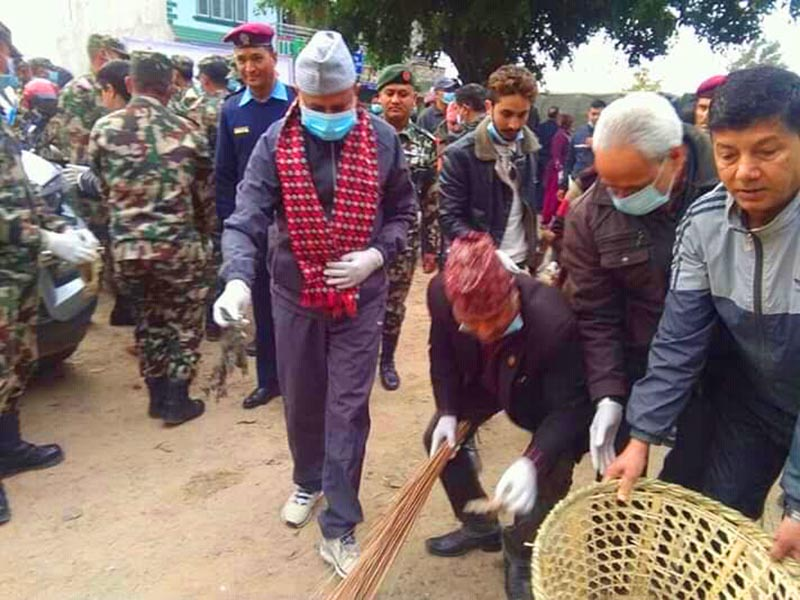 Province 5 Chief Minister Shankar Pokhrel  taking part in a clean-up campaign at Manakamana Chowk of Butwal, in Rupandehi, on Thursday, February 14, 2019. Photo: THT