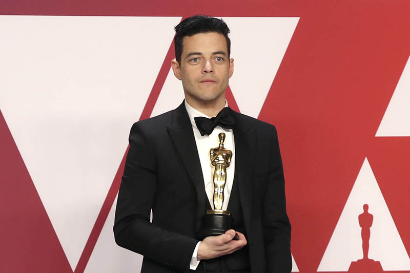 Best Actor Rami Malek poses with his award backstage. Photo: Reuters