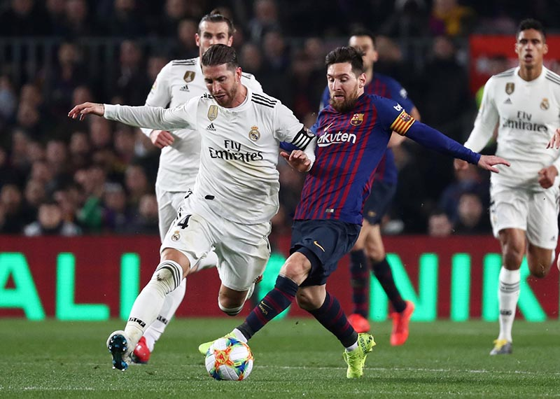 Real Madrid's Sergio Ramos in action with Barcelona's Lionel Messi during the Copa del Rey Semi Final First Leg match between FC Barcelona and Real Madrid, at Camp Nou, in Barcelona, Spain, on February 6, 2019. Photo: Reuters