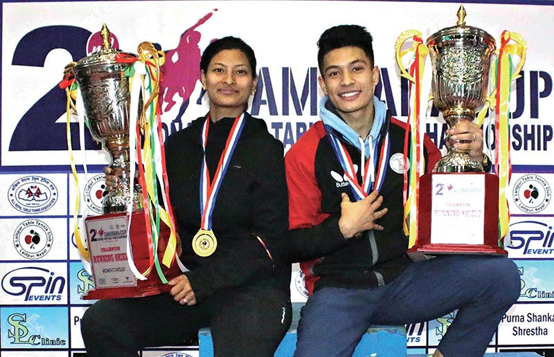 Nabita Shrestha and Santoo Shrestha hold their trophies after the second Samjhana Cup National Open Table Tennis Championship in Kathmandu on Tuesday. Photo: THT