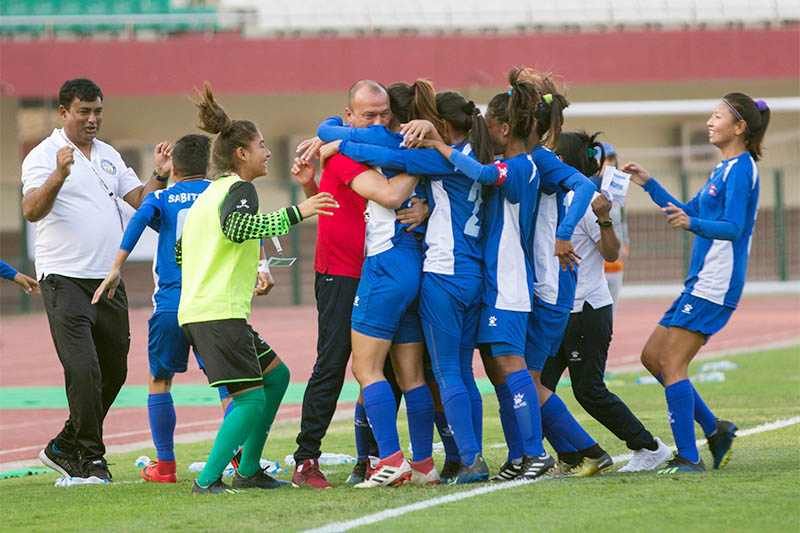 Players celebrate with head coach after scoring a goal against Iran today. Courtesy: ANFA