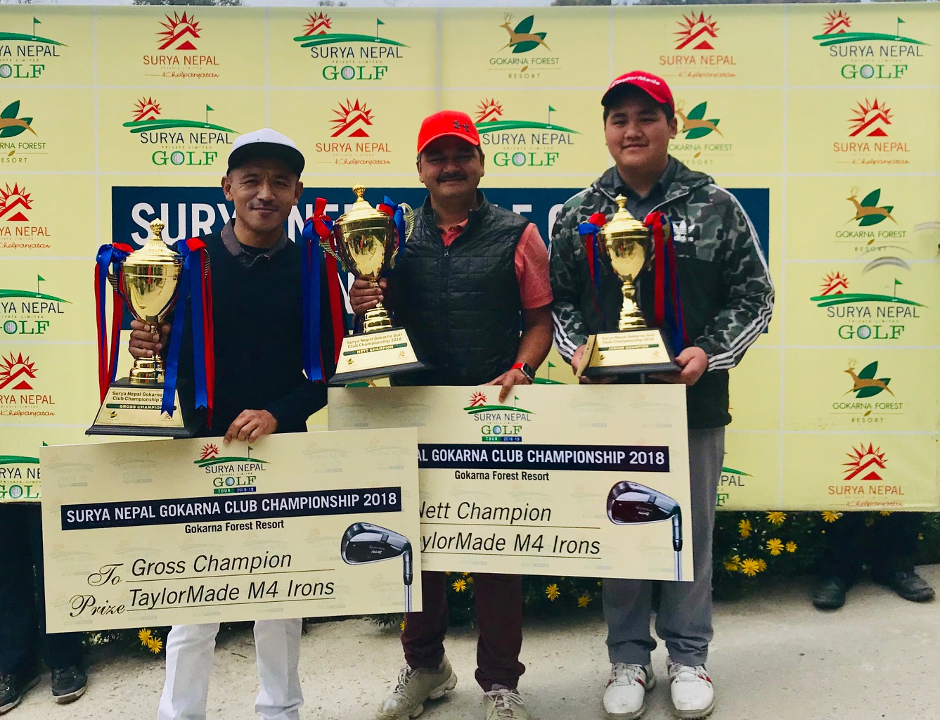 (From left) Tashi Tshiring, Dhurba Thapa and Ang Phurba Sherpa hold the Club Championship trophies after the Surya Nepal Gokarna Monthly Medal on Saturday, February 16, 2019. Photo: THT