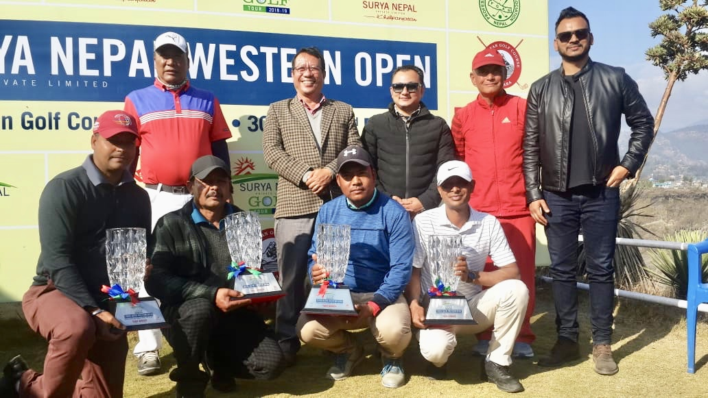 The Surya Nepal Western Open Pro-Am winning team members hold their trophies at the Himalayan Golf Course in Pokhara on Saturday. Photo: THT