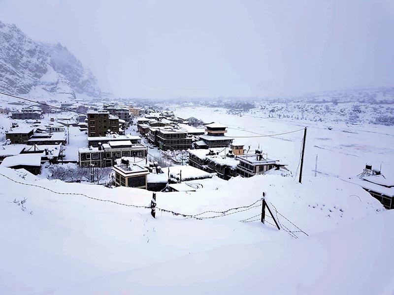 Jomsom bazaar blanketed in snow, in Mustang, on Saturday.