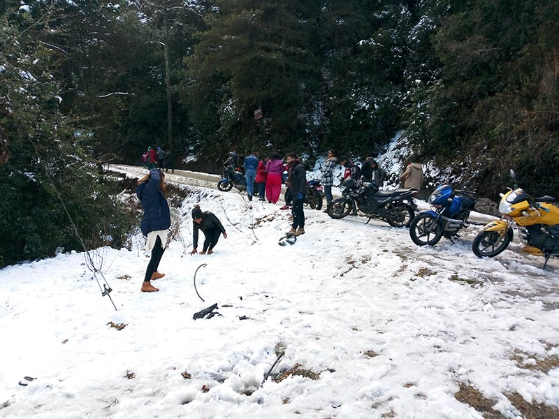 People playing with snow at Daman of Thaha Municipality, on Saturday.