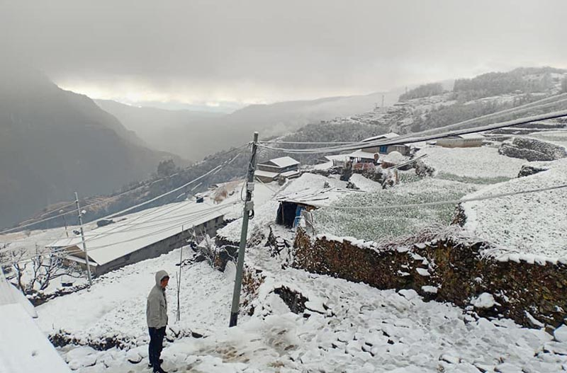 A man looking at snow-covered surroundings in Sikles, Kaski, on Saturday.