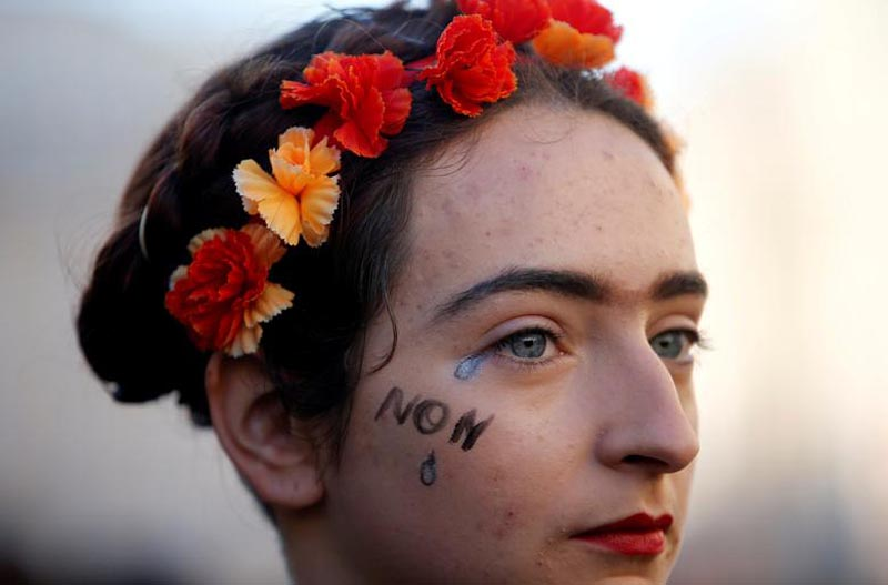 A woman attends a rally against gender-based and sexual violence against women in Marseille, France, on November 24, 2018. Photo: Reuters