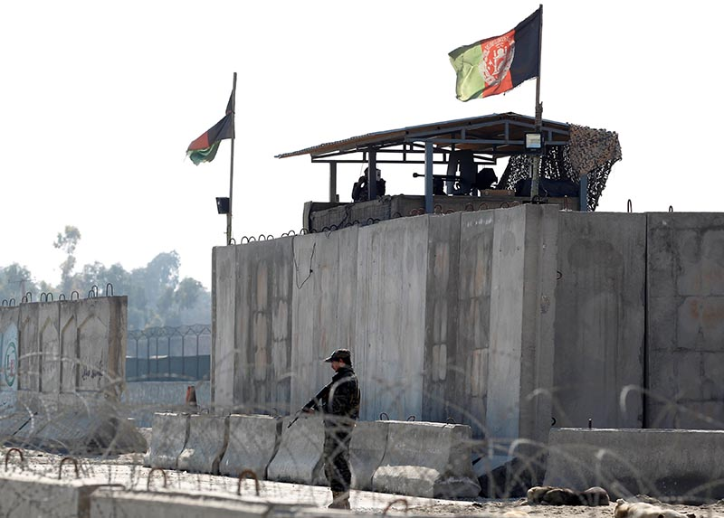 Afghan security forces stand guard near the site of an attack in Jalalabad, Afghanistan March 6, 2019.  Photo: Reuters