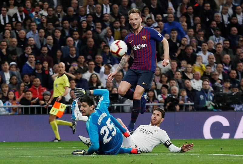 Barcelona's Ivan Rakitic scores their first goal during the La Liga Santander match between Real Madrid and FC Barcelona at Santiago Bernabeu, in Madrid, Spain, on March 2, 2019. Photo: Reuters
