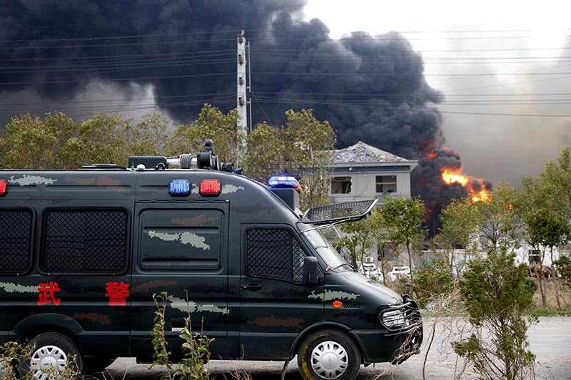 A vehicle of paramilitary police is seen near smoke following an explosion at a chemical industrial park in Xiangshui county, Yancheng, Jiangsu province, China March 21, 2019. Photo: Reuters