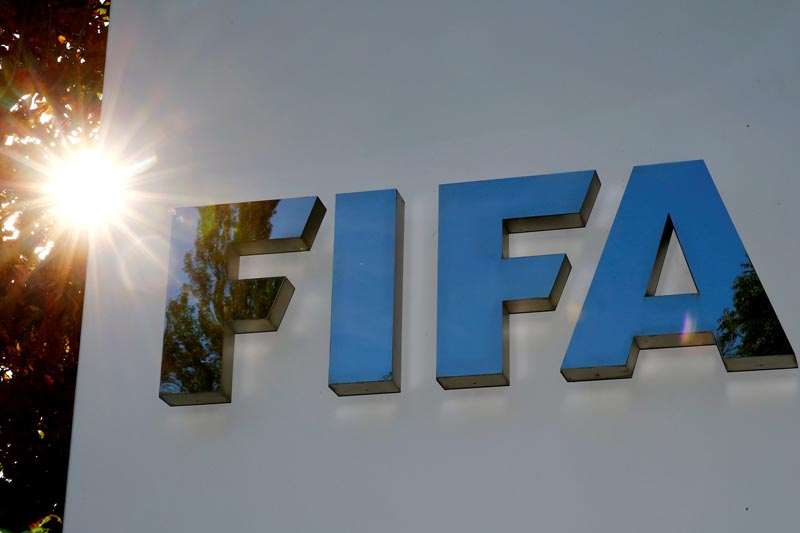 FILE: The logo of FIFA is seen in front of its headquarters in Zurich, Switzerland September 26, 2017. Photo: Reuters/file
