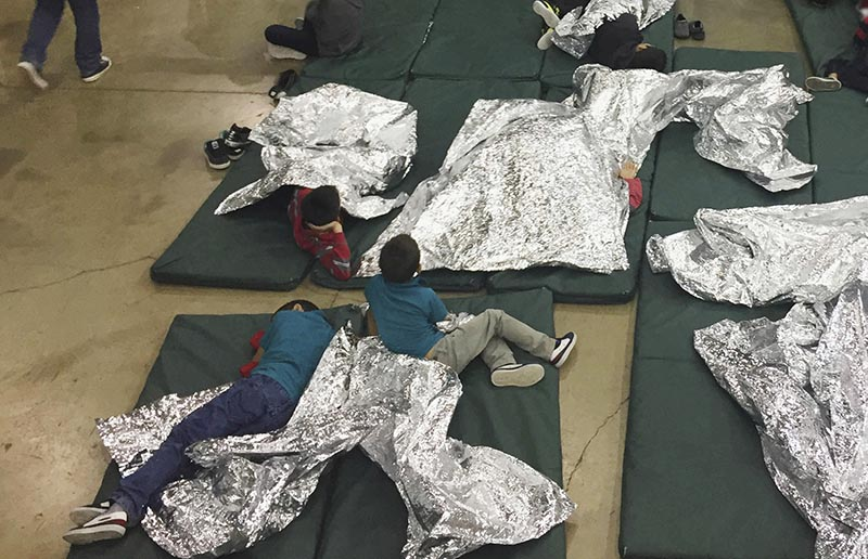 FILE: In this June 17, 2018 file photo provided by US Customs and Border Protection, people who've been taken into custody related to cases of illegal entry into the United States, rest in one of the cages at a facility in McAllen, Texas. Photo: US Customs and Border Protection's Rio Grande Valley Sector via AP/file