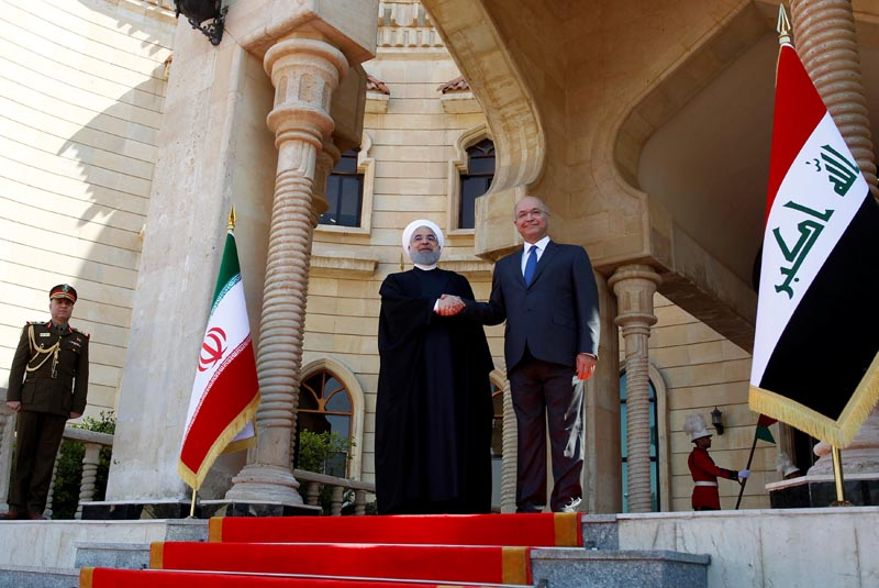 Iraq's President Barham Salih shakes hands with Iranian President Hassan Rouhani during a welcome ceremony at Salam Palace in Baghdad, Iraq March 11, 2019. Photo: Reuters