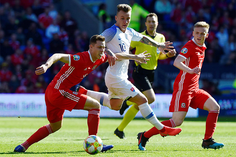 Wales' Jamie Lawrence in action with Slovakia's Albert Rusnak. Photo: Reuters