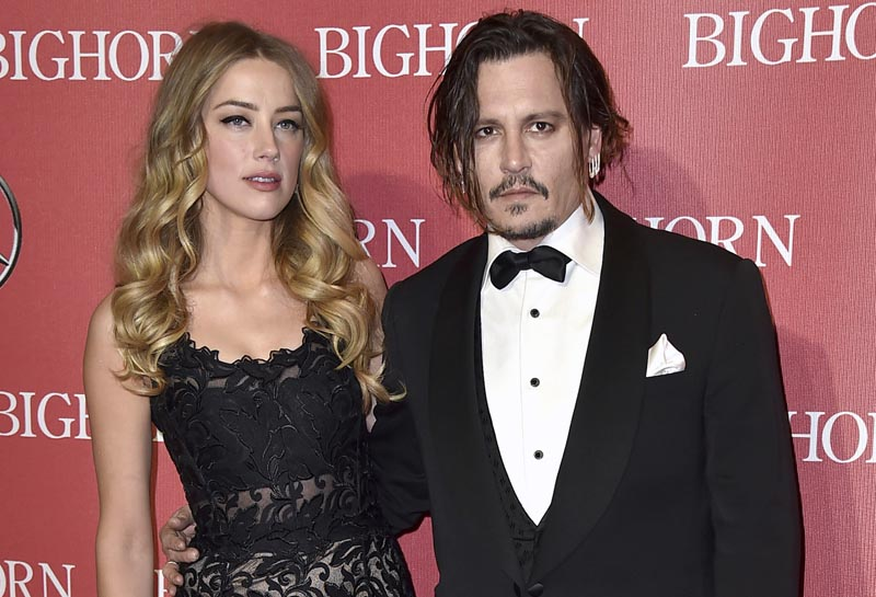 Amber Heard, left, and Johnny Depp arrive at the 27th annual Palm Springs International Film Festival Awards Gala in Palm Springs, California on January 2, 2016. Photo: AP/File