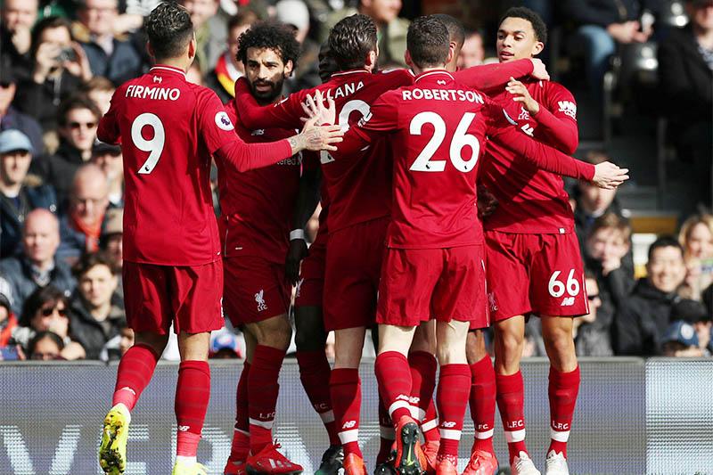 Liverpool's Sadio Mane celebrates scoring their first goal with team mates. Photo: Reuters